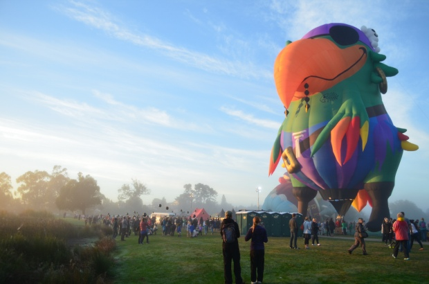 One of the oddly-shaped hot air balloons getting ready to take off during the launch of the festival